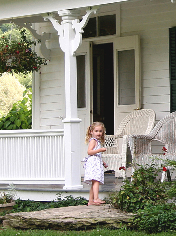 My Daughter, Abigail(a few years ago) on Her Grandparents' Porch