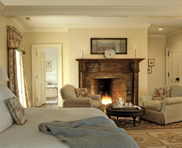 Master Bedroom with Wooden Fireplace Surround