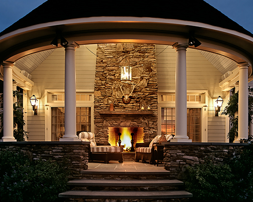 Porch with Outdoor Fireplace at Dusk