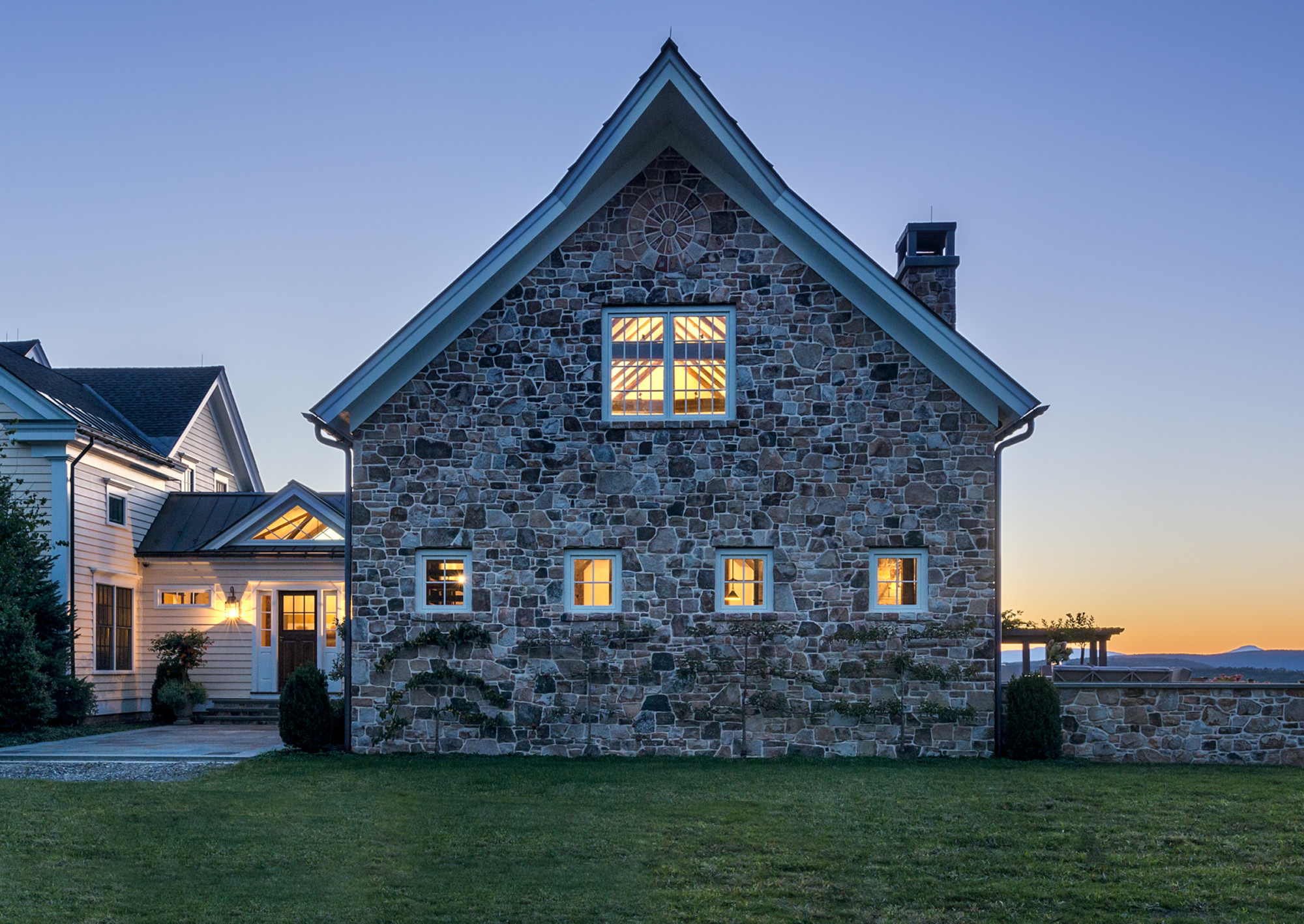 Stone Family Room Addition at Dusk